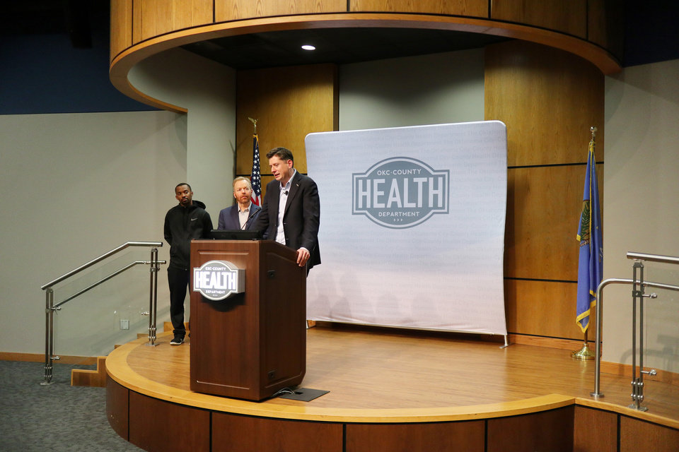 Photo - Eddie Withers, Accute Disease Epidemiologist for OKC-County Health Dept.,Dr. Patrick McGough, Executive Director of OKC-County Health Dept.,and Mayor David Holt talk about the Mayor's declaration of a state of emergency for Oklahoma City after a new case of COVID-19 in the metro area during a press conference at the Oklahoma County Health Department, Sunday March 15, 2020.  [Photo by Doug Hoke/The Oklahoman]