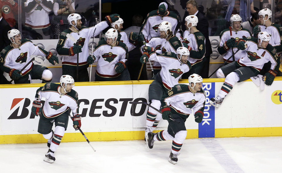 Minnesota Wild players celebrate after beating the Nashville Predators during a shootout in an NHL hockey game Saturday, March 9, 2013, in Nashville, Tenn. The Wild won 2-1. (AP Photo/Mark Humphrey)