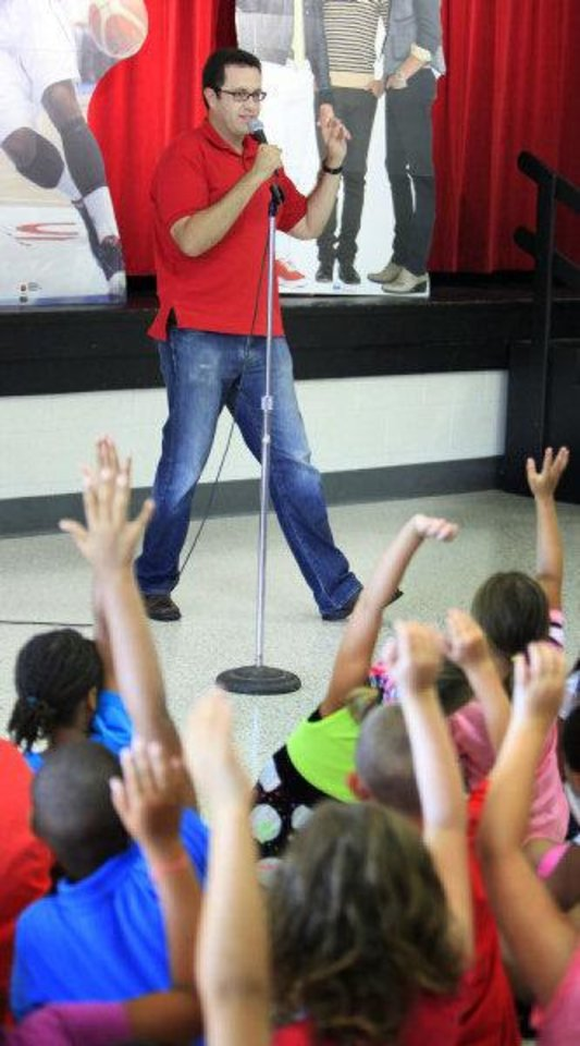Jared Fogle, Subway spokesman, speaks to students about exercising and making healthy eating choices at Soldier Creek Elementary in Midwest City on Friday. <strong>PAUL B. SOUTHERLAND - PAUL B. SOUTHERLAND</strong>