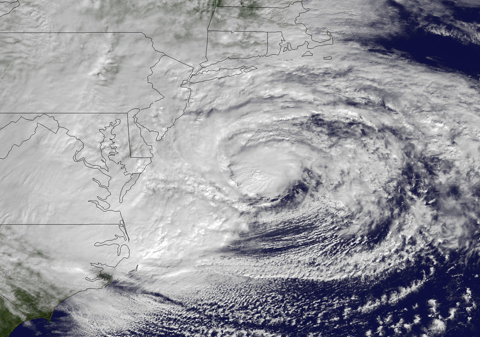Photo -   This NOAA satellite image taken Monday, Oct. 29, 2012 shows Hurricane Sandy off the Mid Atlantic coastline moving toward the north with maximum sustained winds of 90 mph. Hurricane Sandy wheeled toward land as forecasters feared Monday, raking cities along the Northeast corridor with rain and wind gusts, flooding shore towns, washing away a section of the Atlantic City Boardwalk, and threatening to cripple Wall Street and New York's subway system with a huge surge of corrosive seawater. (AP Photo/NOAA)