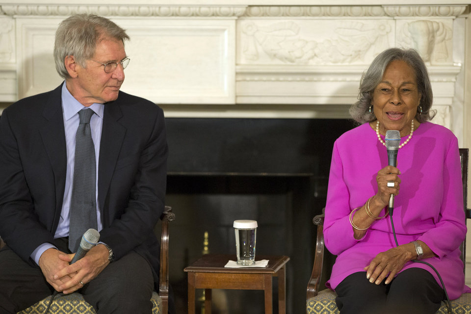 Photo - Actor Harrison Ford listens at left as Rachel Robinson, 90, widow of baseball great Jackie Robinson talks about her late husband during a workshop for high school and college students based on the movie,