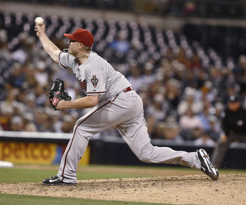 Photo - Arizona Diamondbacks relief pitcher Addison Reed closes out the Diamondabcks' 3-1 victory over the San Diego Padres in the ninth inning of a baseball game  Saturday, June 28, 2014, in San Diego. (AP Photo/Lenny Ignelzi)