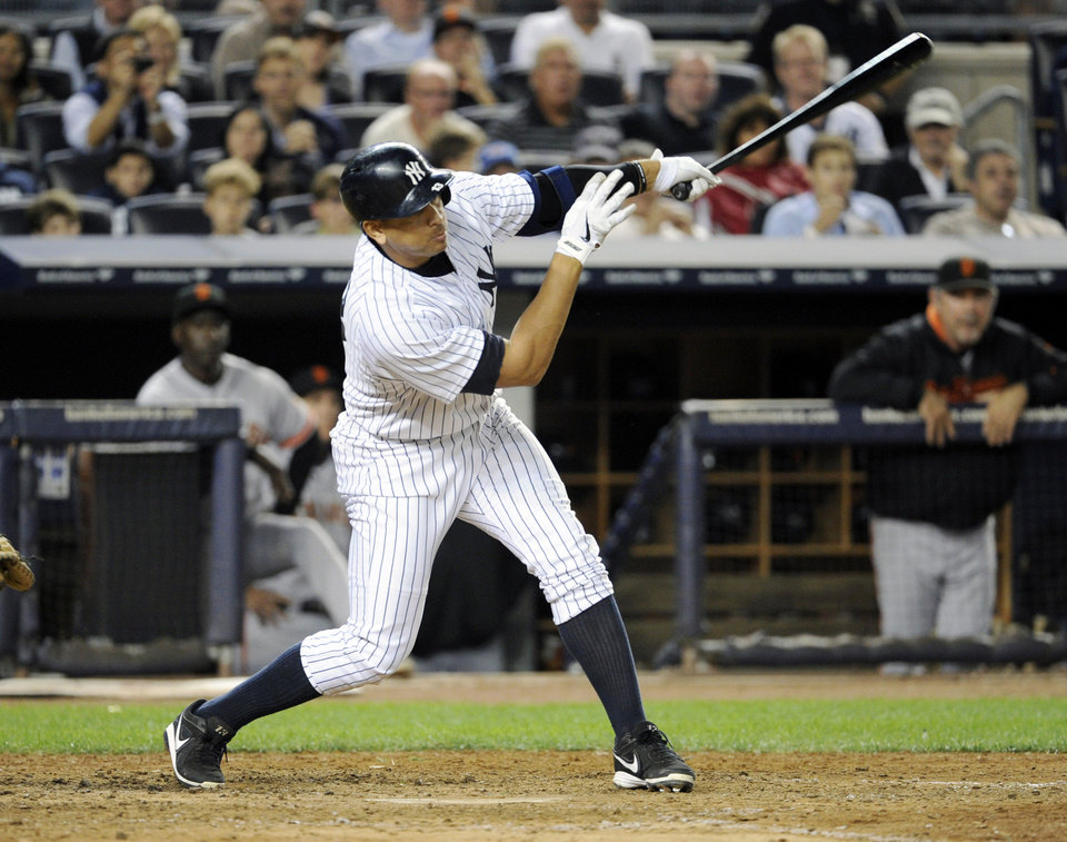 Photo - New York Yankees' Alex Rodriguez follows through on a grand slam during the seventh inning of an interleague baseball game against the San Francisco Giants, Friday, Sept. 20, 2013, at Yankee Stadium in New York. (AP Photo/Bill Kostroun)