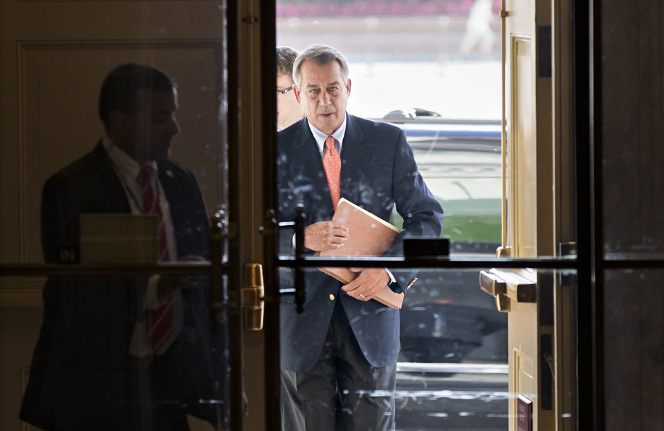 Photo - Speaker of the House John Boehner, R-Ohio, arrives at the Capitol in Washington, Saturday, Oct. 5, 2013. The Republican-controlled House and the Democrat-controlled Senate are at an impasse, neither side backing down after House GOP conservatives linked the funding bill to obstructing President Obama's signature health care law. There has been no sign of progress toward ending the government shutdown that has idled 800,000 federal workers and curbed services around the country.  (AP Photo/J. Scott Applewhite)