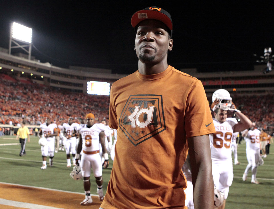 Oklahoma City Thunder\'s Kevin Durant walks off the field following a college football game between Oklahoma State University (OSU) and the University of Texas (UT) at Boone Pickens Stadium in Stillwater, Okla., Saturday, Sept. 29, 2012. Texas on 41-36. Photo by Sarah Phipps, The Oklahoman
