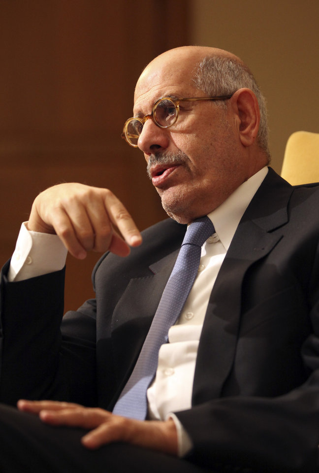 Photo -   Leading democracy advocate Mohammed ElBaradei speaks to a handful of journalists including the Associated Press saying dialogue with Egypt's Islamist president is not possible until he rescinds his decrees giving himself near absolute powers, at his home on the outskirts of Cairo, Egypt, Saturday, Nov. 24, 2012. ElBaradei, a Nobel Peace laureate for his past work as the head of the U.N. nuclear watchdog, has formed a