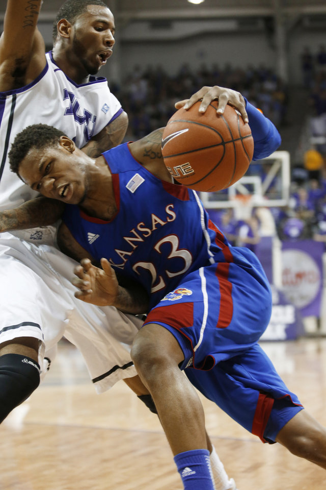 Photo - TCU forward Connell Crossland defends as Kansas guard Ben McLemore (23) drives to the basket during the first half of an NCAA college basketball game Wednesday, Feb. 6, 2013, in Fort Worth, Texas. (AP Photo/Sharon Ellman)