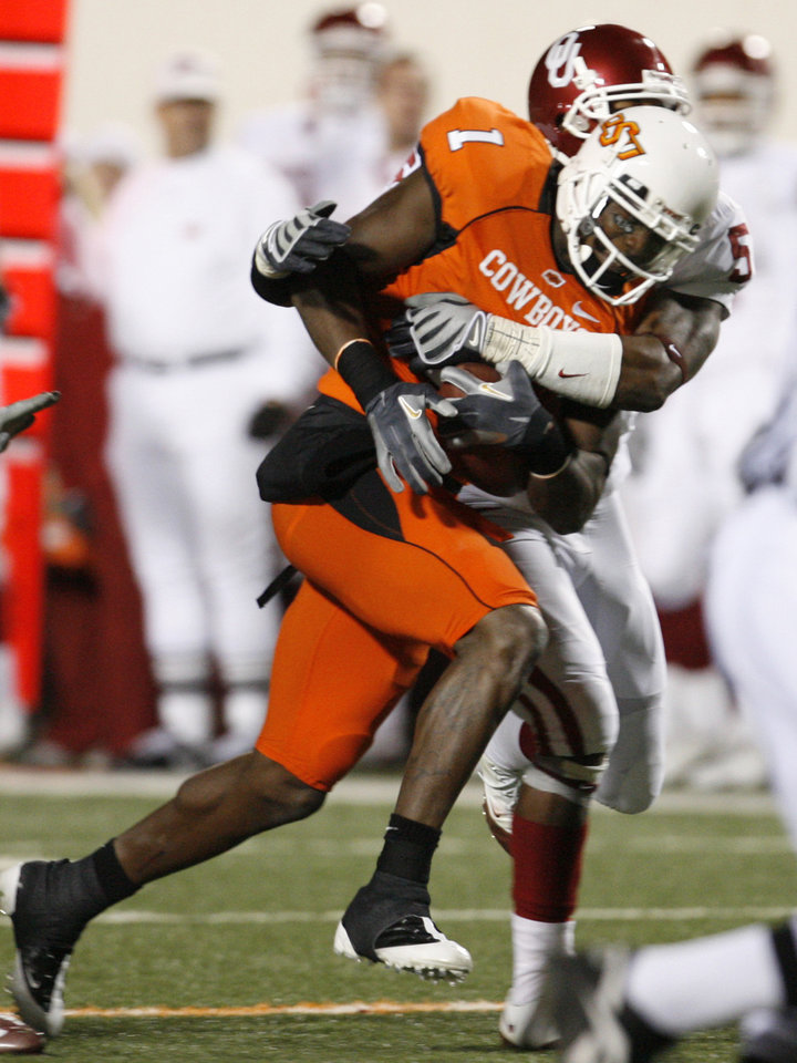 Dez Bryant is brought down after a  36-yard reception during the second half of the college football game between the University of Oklahoma Sooners (OU) and Oklahoma State University Cowboys (OSU) at Boone Pickens Stadium on Saturday, Nov. 29, 2008, in Stillwater, Okla. STAFF PHOTO BY NATE BILLINGS