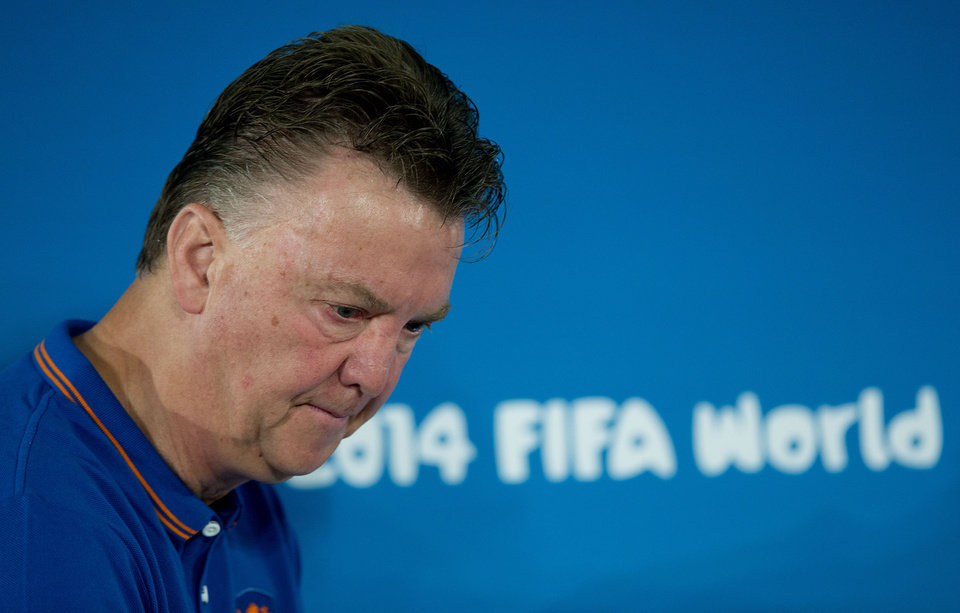 Photo - Netherlands head coach Louis van Gaal arrives for a news conference at the Estadio Nacional in Brasilia, Brazil, Friday, July 11, 2014. The Netherlands will face Brazil in the World Cup third-place match Saturday. (AP Photo/Andre Penner)
