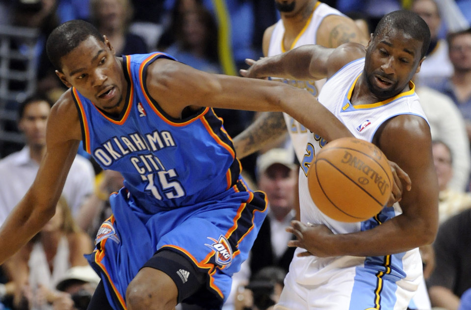Oklahoma City Thunder forward Kevin Durant (35) and Denver Nuggets guard Raymond Felton (20) chase a loose ball during the second half of game 3 of a first-round NBA basketball playoff series Saturday, April 23, 2011, in Denver. (AP Photo/Jack Dempsey)