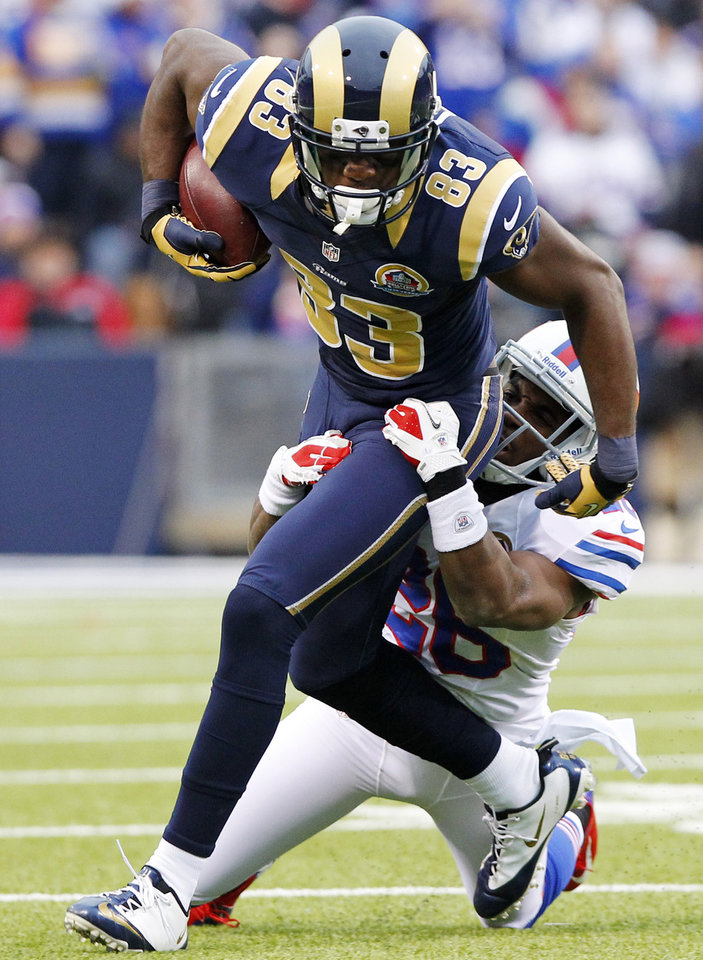 St. Louis Rams wide receiver Brian Quick (83) is tackled by Buffalo Bills defensive back Justin Rogers (26) during the second half of an NFL football game, Sunday, Dec. 9, 2012, in Orchard Park, N.Y. (AP Photo/Bill Wippert)