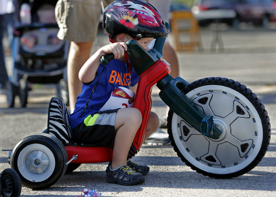 Photo - Eli Hobson, 3, prepares for his heat as children participate in The Ride.  STEVE SISNEY -