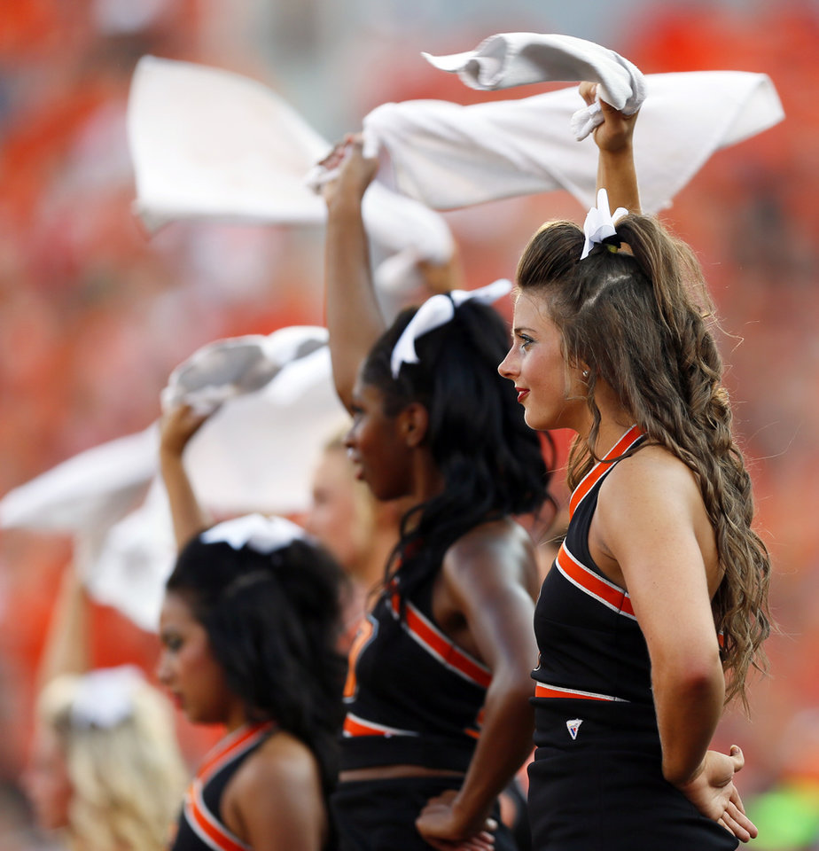 Photo - OSU cheerleaders swing towels while waiting for a kickoff after a score during a college football game between Oklahoma State University (OSU) and Savannah State University at Boone Pickens Stadium in Stillwater, Okla., Saturday, Sept. 1, 2012. Photo by Nate Billings, The Oklahoman