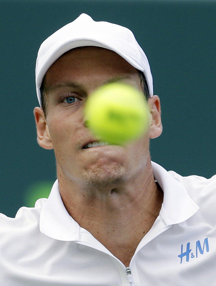Photo - Tomas Berdych, of the Czech Republic, keeps his eyes on the ball as he returns to Alexandr Dolgopolov, of Ukraine, at the Sony Open Tennis tournament in Key Biscayne, Fla., Thursday, March 27, 2014. Berdych won 6-4, 7-6 (3). (AP Photo/Alan Diaz)