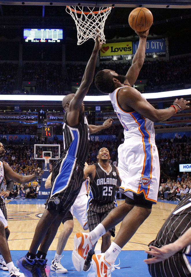 Oklahoma City Thunder's James Harden (13) shoots a lay up as Orlando Magic's Jason Richardson (23) defends during the opening day NBA basketball game between the Oklahoma CIty Thunder and the Orlando Magic at Chesapeake Energy Arena in Oklahoma City, Sunday, Dec. 25, 2011. Photo by Sarah Phipps, The Oklahoman