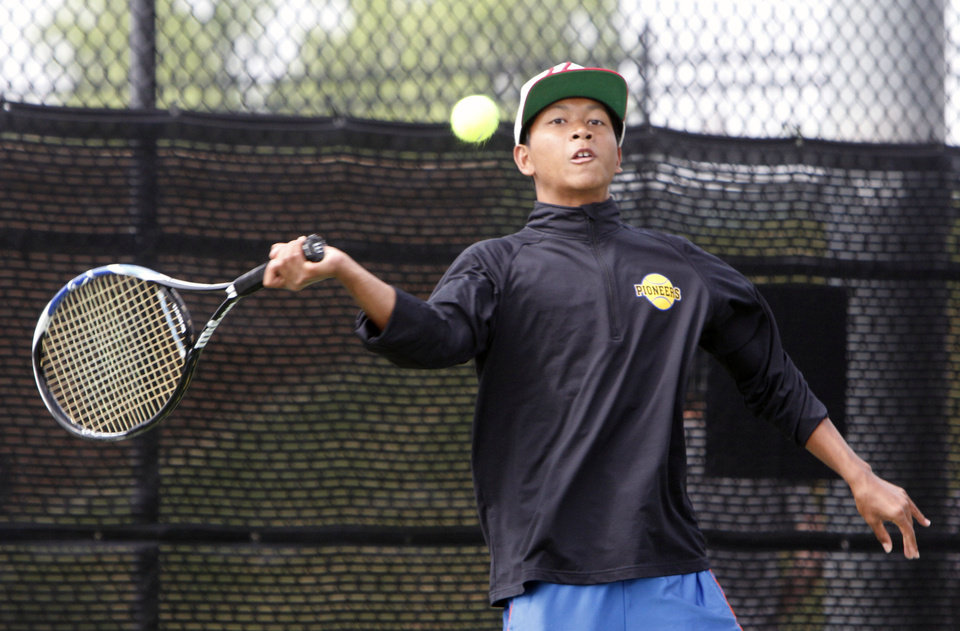 Photo - Stillwater's Noah Smith plays against Edmond North's Nate Roper during the 6A Boy's State Tennis Tournament at the OKC Tennis Club in Oklahoma City, OK, Friday, May 10, 2013,  By Paul Hellstern, The Oklahoman