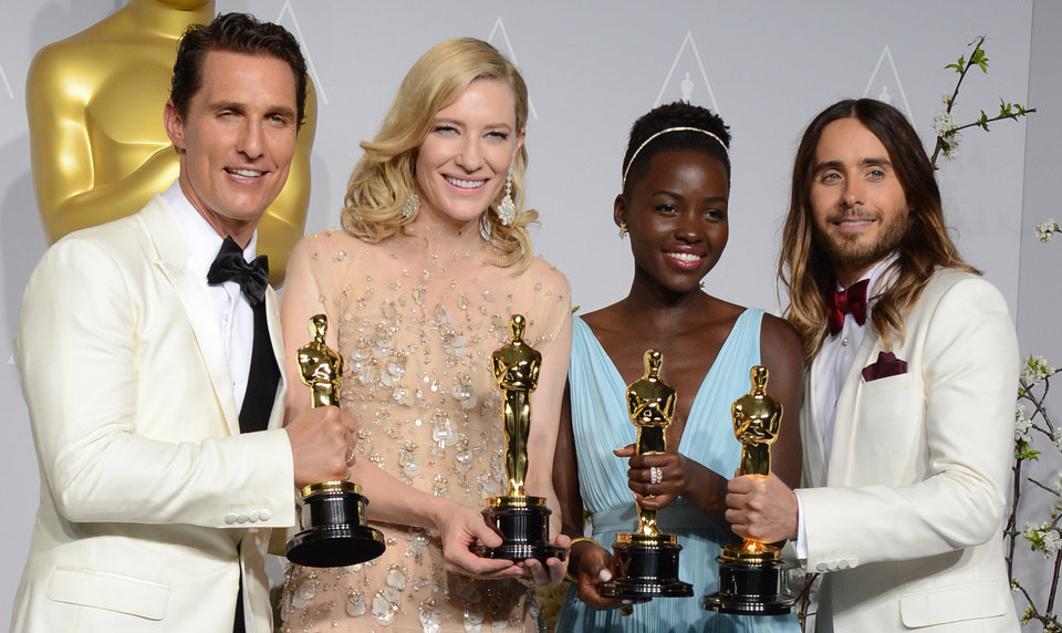 Photo - Matthew McConaughey, from left, holds his award for best actor for his role in