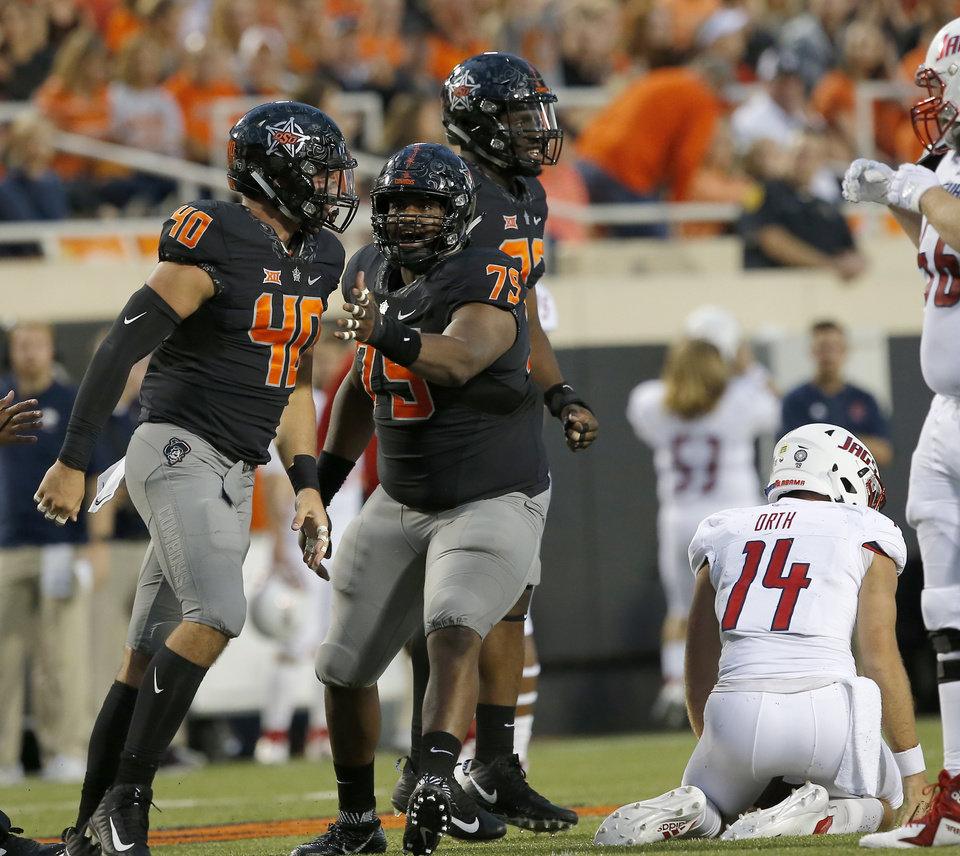 Photo - Oklahoma State's Brock Martin (40) and Darrion Daniels celebrate a sack on South Alabama's Evan Orth (14)  during a college football game between Oklahoma State (OSU) and South Alabama at Boone Pickens Stadium in Stillwater, Okla., Saturday, Sept. 8, 2018. Photo by Sarah Phipps, The Oklahoman