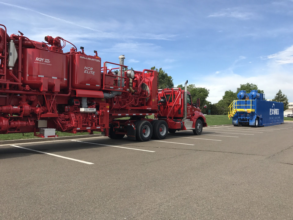 Photo - Oil field service equipment, one from Halliburton and another from Rockwater Energy Solutions, were left in the Oklahoma Capitol parking lot over the weekend and remained there Monday morning. Photo by Dale Denwalt, The Oklahoman