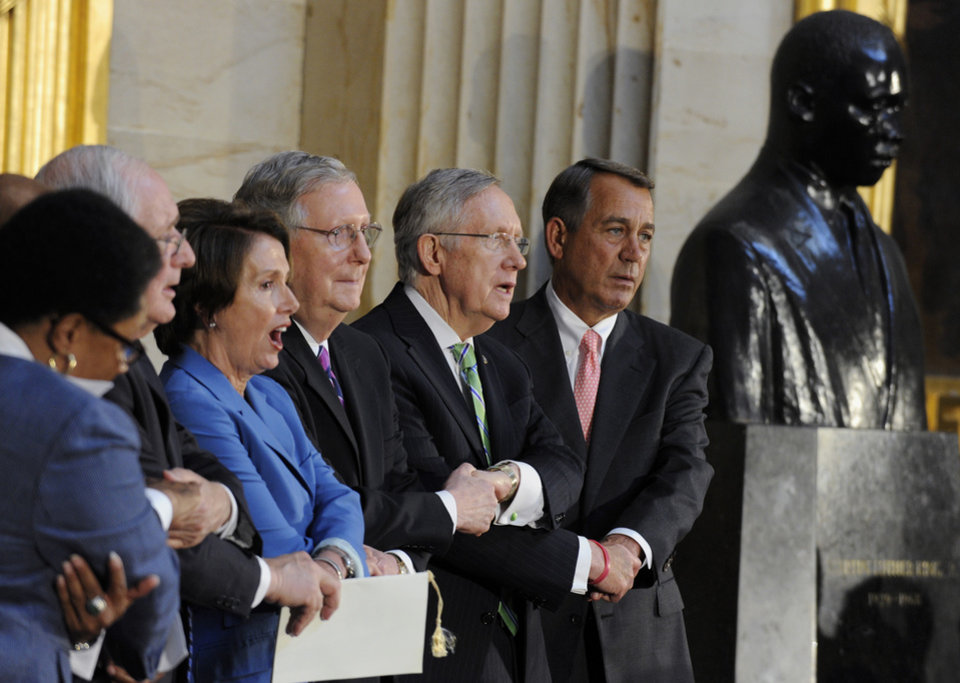 Photo - From right to left, House Speaker John Boehner of Ohio, Senate Majority Leader Harry Reid of Nev., Senate Minority Leaders Mitch McConnell of Ky., House Minority Leader Nancy Pelosi of Calif., and Sen. Carl Levin, D-Mich. hold hands as they sing,