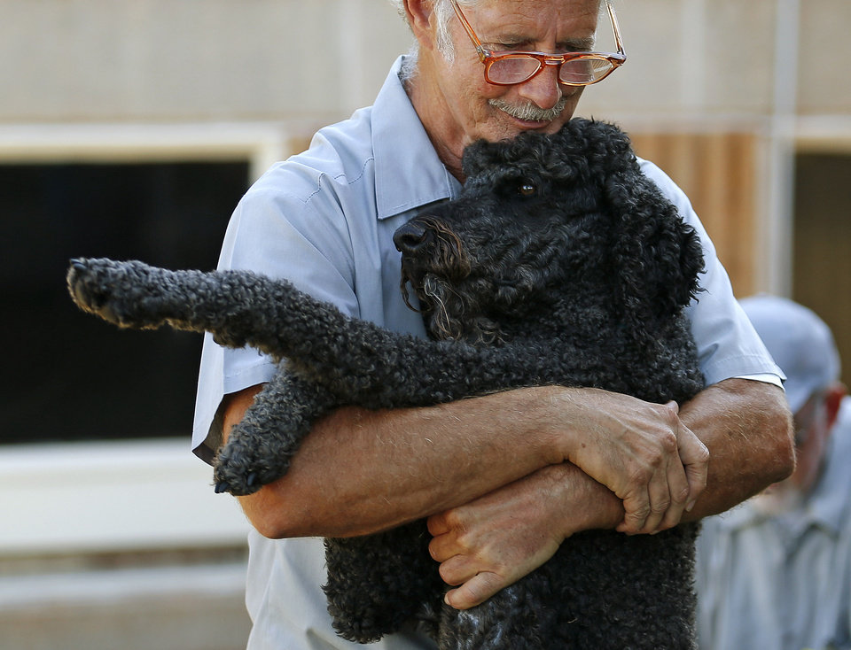 PRISON INMATES / DOGS: Bill Gassaway hugs Luke at the Lexington Assessment and Reception Center, Friday, July 11,  2013, in Lexington, Okla. Photo by Sarah Phipps, The Oklahoman