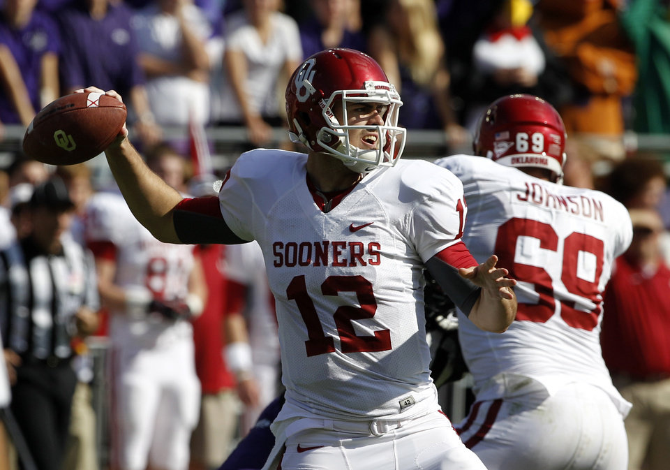 Photo - Oklahoma quarterback Landry Jones (12) passes against TCU during the first half of an NCAA college football game, Saturday, Dec. 1, 2012, in Fort Worth, Texas. (AP Photo/Tony Gutierrez)