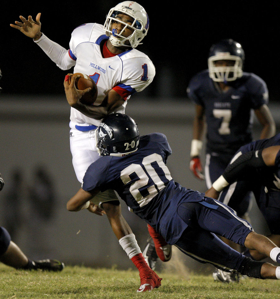 Millwood's Dametric Sanders tries to get by Star Spencer's Montreal Alexander during a high school football game at Star Spencer in Oklahoma City, Friday, September 2, 2011. Photo by Bryan Terry, The Oklahoman