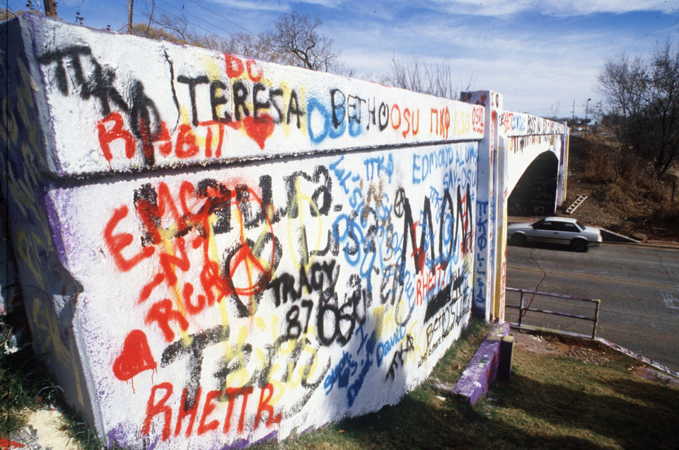 Photo - Graffiti bridge at NW 59th and Western Ave.  Staff photo by Argo.  Photo undated and published on 12/04/1987 in The Daily Oklahoman.
