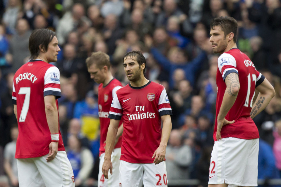 Photo - Arsenal's Mathieu Flamini, centre, stands amongst teammates as they wait for play to restart after Everton's second goal during their English Premier League soccer match at Goodison Park Stadium, Liverpool, England, Sunday April 6, 2014. (AP Photo/Jon Super)