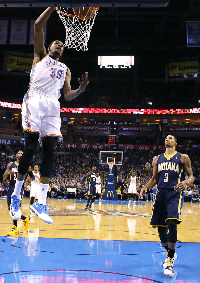 Photo - Oklahoma City's Kevin Durant (35) dunks in front of Indiana's George Hill (3) during the NBA game between the Oklahoma City Thunder and the Indiana Pacers at the Chesapeake Energy Arena, Sunday, Dec. 8, 2013. Photo by Sarah Phipps, The Oklahoman