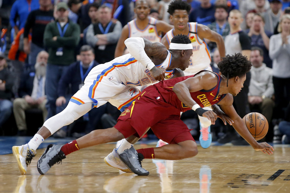 Photo - Oklahoma City's Dennis Schroder (17) knocks the ball away from Cleveland's Collin Sexton (2) during an NBA basketball game between the Oklahoma City Thunder and the Cleveland Cavaliers at Chesapeake Energy Arena in Oklahoma City, Wednesday, Feb. 5, 2020. Oklahoma City won 109-103. [Bryan Terry/The Oklahoman]