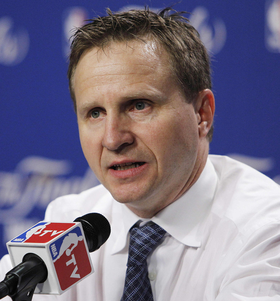 Oklahoma City Thunder head coach Scott Brooks answers a question during a news conference after Game 4 of the NBA finals basketball series against the Miami Heat, Tuesday, June 19, 2012, in Miami. The Miami Heat won 104-98. (AP Photo/Lynne Sladky)  ORG XMIT: NBA176