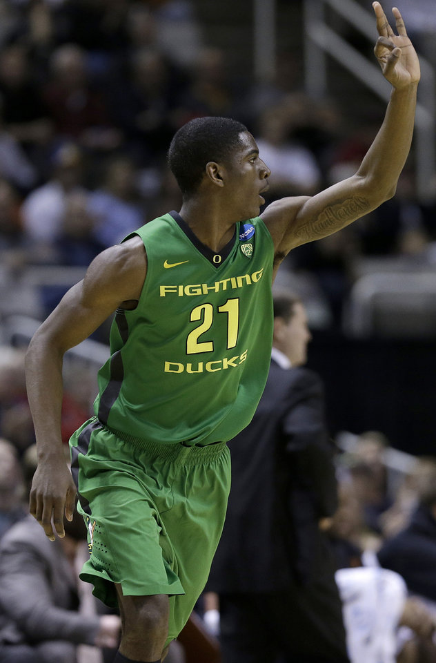 Oregon guard Damyean Dotson (21) gestures after making a three-point basket against Oklahoma State during the first half of a second-round game in the NCAA college basketball tournament in San Jose, Calif., Thursday, March 21, 2013. (AP Photo/Jeff Chiu) ORG XMIT: SJA121
