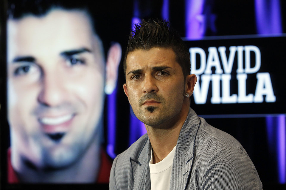Photo - FILE - This is a July 15, 2013 file photo showing Atletico de Madrid's soccer player  David Villa during his presentation at the Vicente Calderon Stadium in Madrid. Villa has signed a three-year contract with New York City FC, becoming the first player on the expansion Major League Soccer team that starts play next season. (AP Photo/Andres Kudacki, File)