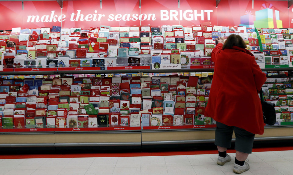 In this Wednesday, Dec. 19, 2012, photo, a customer shops for greeting cards at a Target store in Chicago. U.S. holiday retail sales this year are the weakest since 2008, after a shopping season disrupted by storms and rising uncertainty among consumers. A report out Tuesday, Dec. 25, 2012, that tracks spending, called MasterCard Advisors SpendingPulse, says holiday sales increased 0.7 percent. Analysts had expected sales to grow 3 to 4 percent. (AP Photo/Nam Y. Huh)