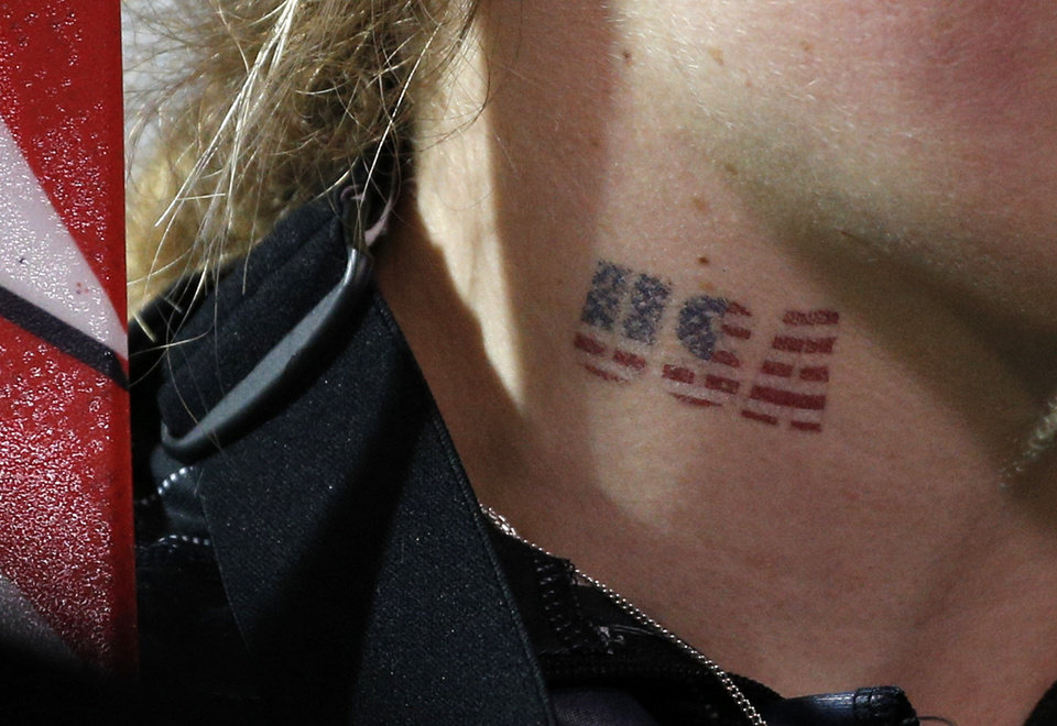 Photo - United States' Mikaela Shiffrin wears a temporary tattoo as she celebrates her gold medial win in the women's slalom at the Sochi 2014 Winter Olympics, Friday, Feb. 21, 2014, in Krasnaya Polyana, Russia. (AP Photo/Christophe Ena)