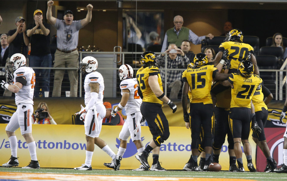 Missouri's Henry Josey (20) celebrates with teammates after a touchdown during the AT&T Cotton Bowl Classic college football game between the Oklahoma State University Cowboys (OSU) and the University of Missouri Tigers at AT&T Stadium in Arlington, Texas, Friday, Jan. 3, 2014. Photo by Bryan Terry, The Oklahoman