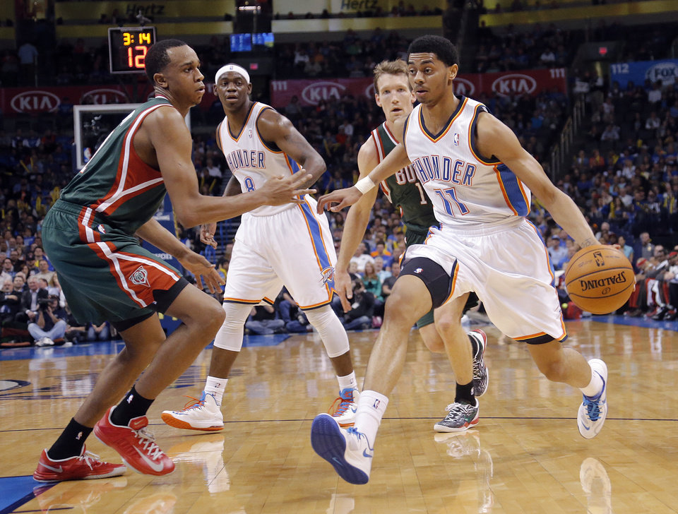 Oklahoma City's Jeremy Lamb (11) drives past Milwaukee's John Henson (31) during the season finale NBA basketball game between the Oklahoma City Thunder and the Milwaukee Bucks at Chesapeake Energy Arena on Wednesday, April 17, 2013, in Oklahoma City, Okla.   Photo by Chris Landsberger, The Oklahoman