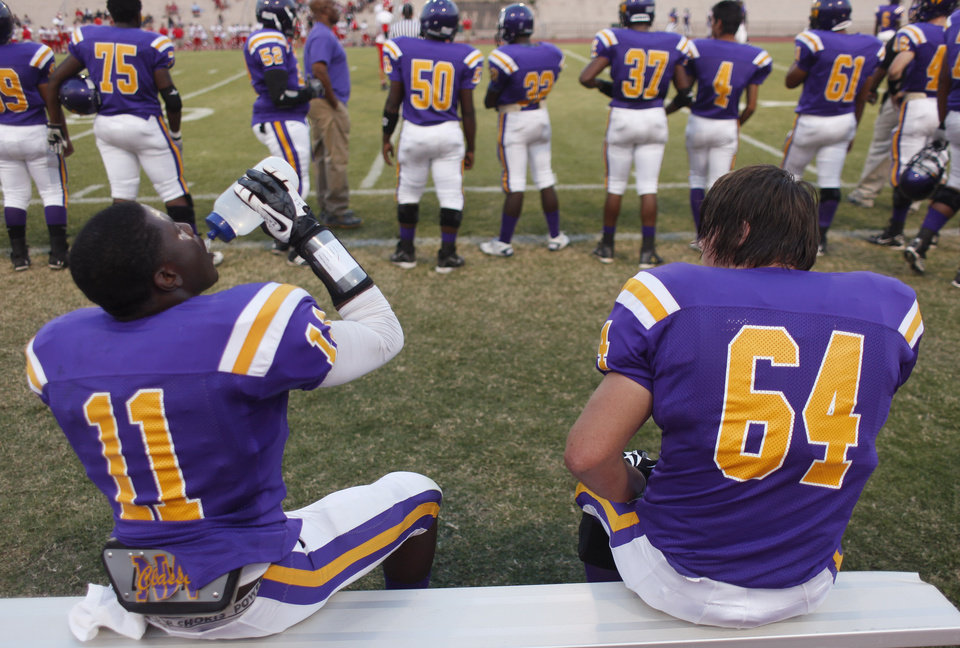 Isiah Beverly (11) gets a drink while Zach Hobgood (64) watches at the Northwest Classen vs. Western Heights high school football game at Taft Stadium Thursday, September 20, 2012. Photo by Doug Hoke, The Oklahoman