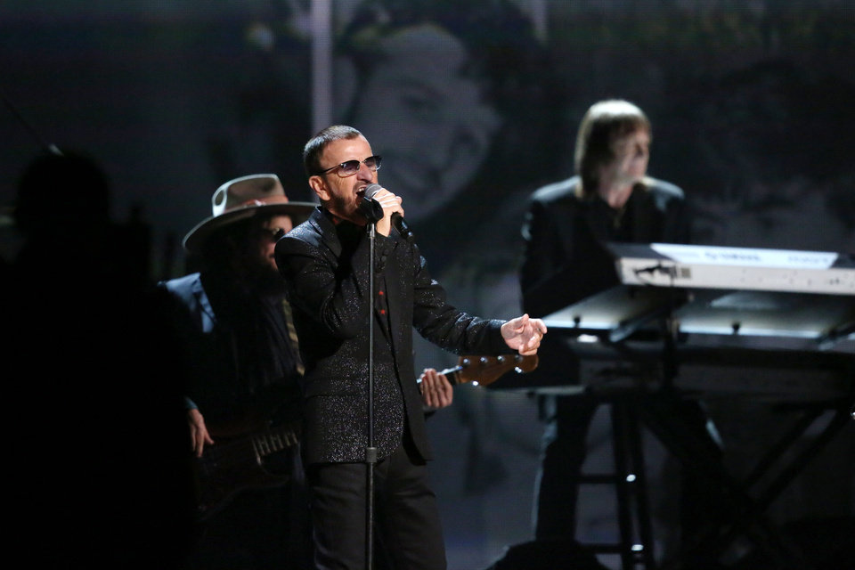 """Photo - Ringo Starr performs """"Photograph"""" at the 56th annual Grammy Awards at Staples Center on Sunday, Jan. 26, 2014, in Los Angeles. (Photo by Matt Sayles/Invision/AP)"""
