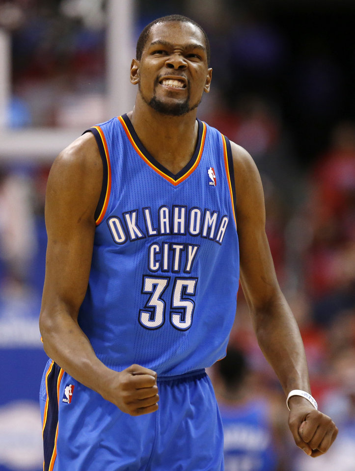 Photo - Oklahoma City's Kevin Durant (35) reacts in the fourth quarter during Game 6 of the Western Conference semifinals in the NBA playoffs between the Oklahoma City Thunder and the Los Angeles Clippers at the Staples Center in Los Angeles, Thursday, May 15, 2014. Photo by Nate Billings, The Oklahoman