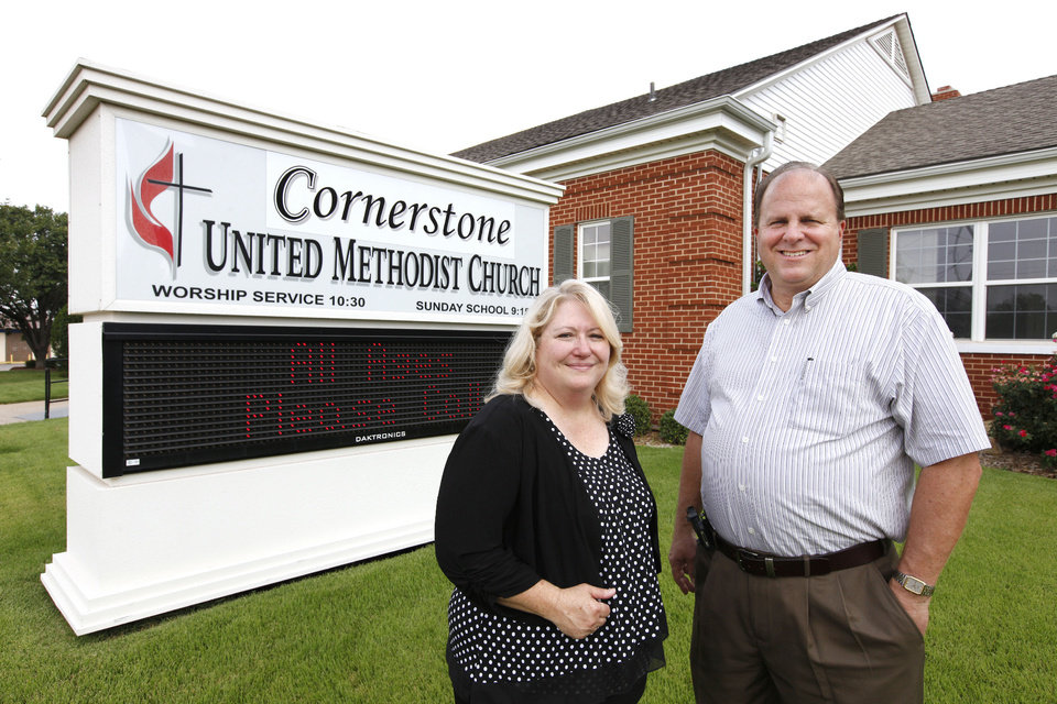 Photo - The Rev. Diana Pruitt and the Rev. Steve Brant stand outside Cornerstone United Methodist Church, 2604 N May Ave., where they serve as co-pastors.   PAUL B. SOUTHERLAND - PAUL B. SOUTHERLAND