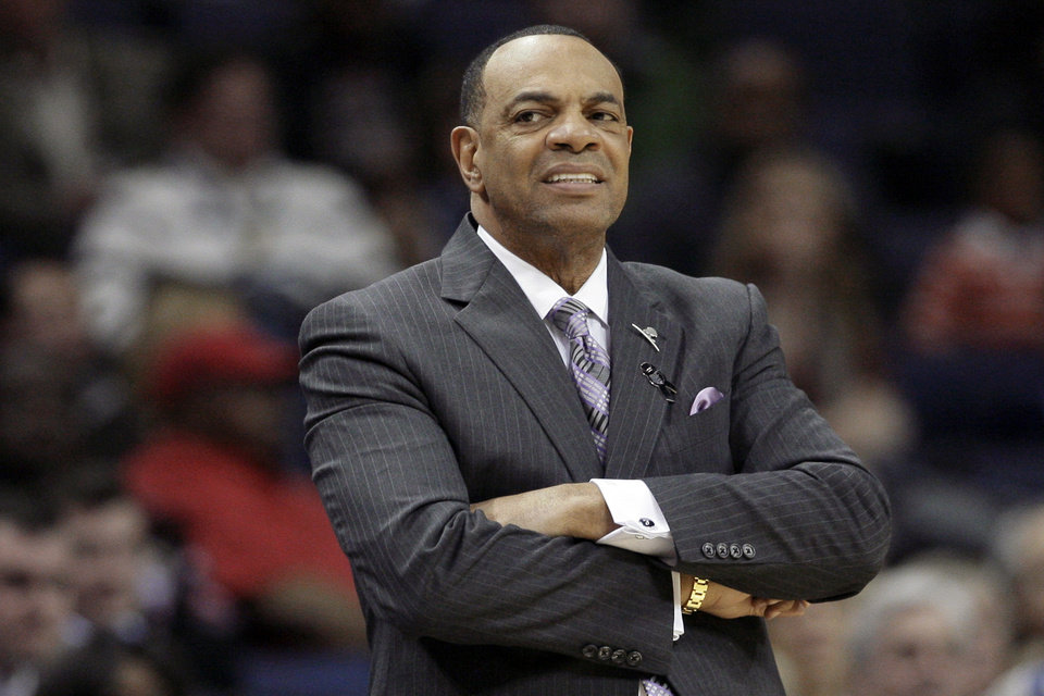Photo - Memphis Grizzlies coach Lionel Hollins watches the first half of an NBA basketball game against Portland Trail Blazers in Memphis, Tenn., Wednesday, March 6, 2013. (AP Photo/Danny Johnston)