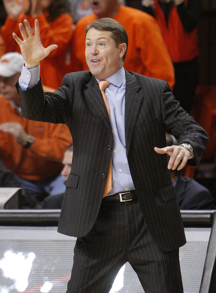 Photo - OSU head coach Travis Ford gives instructions to his team during the men's college basketball game between Oklahoma State University (OSU) and Kansas State University (KSU) at Gallagher-Iba Arena in Stillwater, Okla., Saturday, January 8, 2011. OSU won, 76-62. Photo by Nate Billings, The Oklahoman