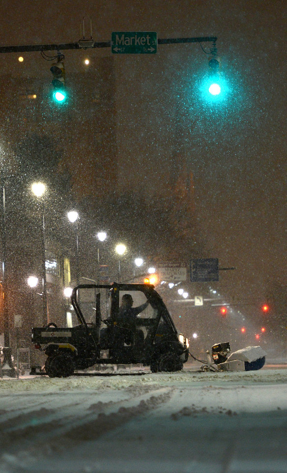 Photo - A sidewalk snow plow clears the intersection of Market Street and North Washington Street, Thursday Jan. 2, 2014 in Wilkes-Barre, Pa. as the snow continues to fall. (AP Photo Citizens' Voice, Andrew Krech) MANDATORY CREDIT