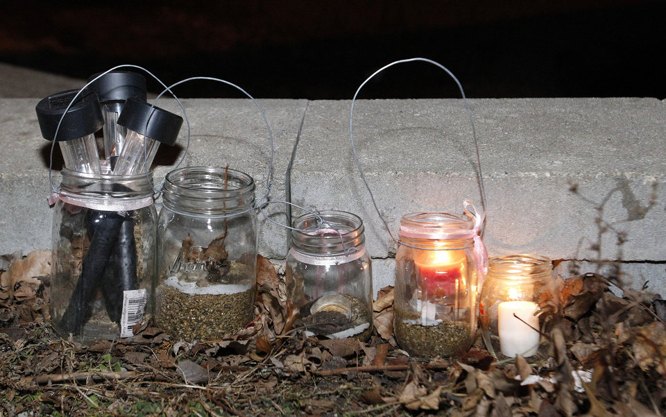 Lanterns rest on the ground during a meeting held at Meyers lake in Evansdale, Iowa on Wednesday, Dec. 5, 2012. Hunters discovered two bodies Wednesday believed to be the young Iowa cousins who vanished five months ago while riding their bikes, authorities said. (AP Photo/Waterloo Courier, Dawn J. Sagert)