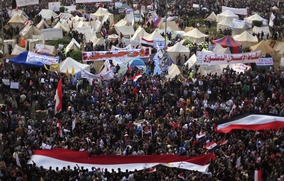 Egyptian protesters attend an opposition rally in Tahrir Square in Cairo, Egypt, Tuesday, Nov. 27, 2012. Thousands flocked to Cairo's central Tahrir square on Tuesday for a protest against Egypt's president in a significant test of whether the opposition can rally the street behind it in a confrontation aimed at forcing the Islamist leader to rescind decrees that granted him near absolute powers.(AP Photo/Khalil Hamra)