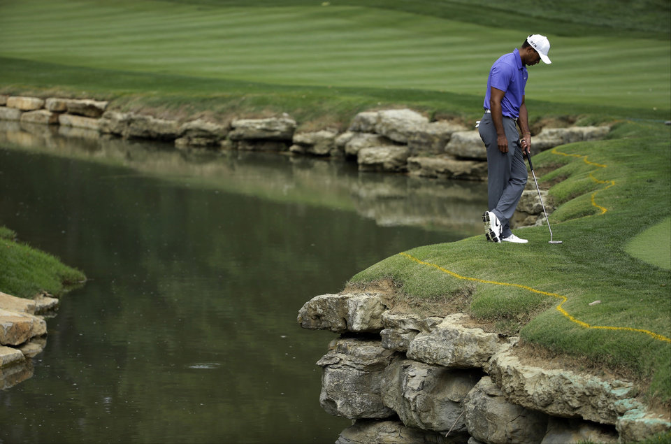 Photo - Tiger Woods stands on the edge of the 15th green during the first round of the PGA Championship golf tournament at Valhalla Golf Club on Thursday, Aug. 7, 2014, in Louisville, Ky. (AP Photo/Jeff Roberson)