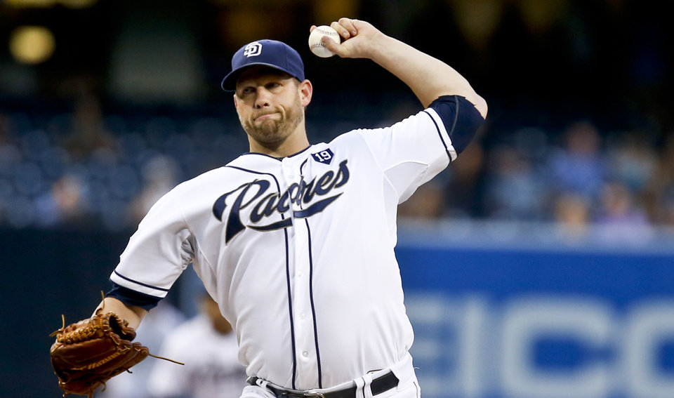 Photo - San Diego Padres starting pitcher Eric Stults works against the Milwaukee Brewers in the first inning of a baseball game Monday, Aug. 25, 2014, in San Diego.  (AP Photo/Lenny Ignelzi)