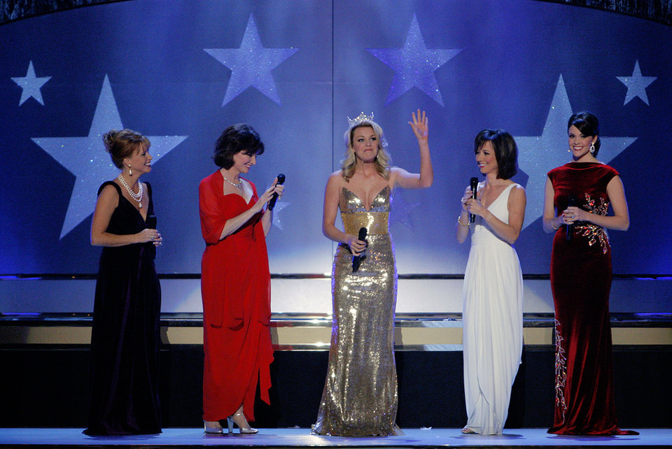 Photo - Miss American Lauren Nelson waves to the crowd as she is surrounded by former Miss Americas Shawntel Smith Wuerch, Jane Jayroe Gamble, from left, Susan Powell and Jenniver Berry Gooden, right, during the Centennial Spectacular to celebrate the 100th birthday of the State of Oklahoma at the Ford Center on Friday, Nov. 16, 2007, in Oklahoma City, Okla. Photo By CHRIS LANDSBERGER, The Oklahoman
